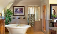 An antique reproduction bathtub, large walk-in shower with glass door and extensive tile work are the hallmarks of this executive master bath. Designed by HartmanBaldwin Design/Build