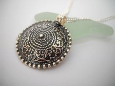 Check out this item in my Etsy shop https://www.etsy.com/listing/217693947/filigree-pendant-oxidized-silver