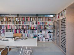 studio with clerestory windows, built-in bookshelves, and flat files