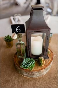 candle lit lantern centerpiece and chalkboard table number centerpiece