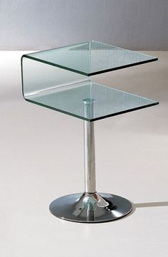 """03 Modern End Table SKU1751513 Description :  Glass B-03 Modern Coffee Table - J&M Furniture. Can be used as book rack. In fact it will enhance the stylish look of the living room. The table looks solid and delicate. But you can be rest assured that this solid coffee table will be easy to clean and maintain. It will retain its lovely looks for several years. Features: Glass End Table Free Shipping Dimensions: End Table : W""""18.5 x D""""16 x H""""28"""