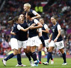 Abby Wambach celebrates with team mates