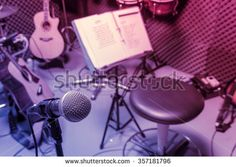 selective focus microphone and blur musical equipment guitar ,lyric, drum piano…