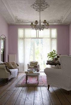 pink vintage.. living room with white linen and pale pink, chandelier