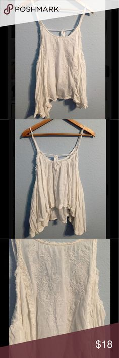 Free People Flowy White Fringe Tank Near perfect condition Free People white Tank with fringe and floral embroidery. Ties in the back. Free People Tops Tank Tops