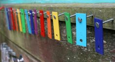 take apart a xylophone to make a fun music wall for your fence
