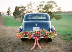 """Floral wedding car decoration for the arrival & just add the """"just married"""" & cans for the getaway!"""