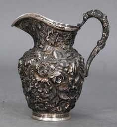 Nadeau's Auctions - Stieff sterling silver pitcher, floral repousse with repousse handle. Provenance: Connecticut Historical Society 23.8 t oz. - Realized Price: $2,242.00