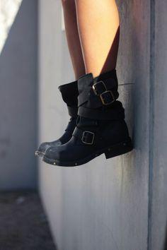Black buckle moto boots.