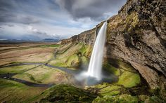 """""""Seljalandsfoss"""" -- #wallpaper by """"deltron"""" from http://interfacelift.com -- With a 200 foot fall and the rare feature of actually being able to walk behind the waterfall on the rock shelter, Seljalandsfoss is one of the most famous waterfalls.  ND 3.0, Adobe Lightroom. -- Available as #wallpapers in any resolution at: http://interfacelift.com/wallpaper/details/3914/seljalandsfoss.html"""