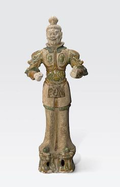 A LARGE SANCAI GLAZED GUARDIAN FIGURE Tang dynasty
