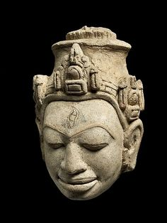 8th C. Male Divinity with Hindu features prob. subject to Buddhist Law. Central Thailand. Stucco
