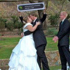 """The officiator held up this sign during the """"First Kiss"""". For all you video game nerds :P"""