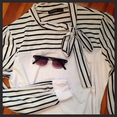 Pretty Black & White Top Sz L Size L black and white top. Made of T-shirt material. Ties at neck. Very feminine and flattering!  In like new condition. Fits true to size. Fair offers welcome. Zanzea Tops Blouses