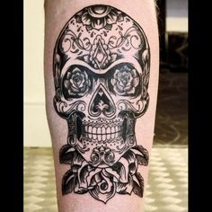 Candy skull calf tattoo