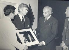 Zulfikar Ali Bhutto (1928-1979) the Pakistani Prime Minister (right) with the last Man in space Eugene Cernan - presenting Bhutto a photo capture on the moon!