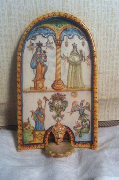 Jeffrey Gueno and Frank Hanley,Le Chateau Interiors, IGMA fellows - Faience Fountain depicting biblical scenes including Crowning of Mary and Daniel Slaying a Dragon, sold on ebay for $815
