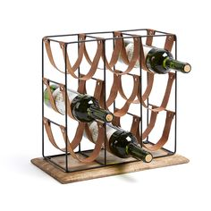 Bottle rack in metal, mango wood and leather. Wood And Metal, Solid Wood, Hanging Wine Rack, Wine Bottle Rack, Wine Racks, Rack Design, Floor Colors, Worcester, How To Distress Wood