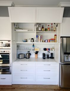 APPLIANCE CABINET. Blum servo drive lift up doors, Soft closing Bi-fold doors & power points so appliances can be used where they are. #kbecastlehill #kitchensbyemanuel #kitchenideas #appliancecabinet #ideas #custom #local #storage #practical