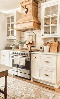 If you are inspired by french country kitchens and modern farmhouse kitchens you have come to the right place. This kitchen is dreamy with the shiplap walls and reclaimed wood. I adore the white kitchen cabinets and vintage home decor. French Country Kitchens, Modern Farmhouse Kitchens, Home Kitchens, Country Farmhouse Kitchen, Farmhouse Style, Country Kitchen Designs, Farmhouse Homes, Rustic White Kitchens, Interior Design Farmhouse