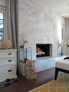 fireplace ... made modern with marble tile