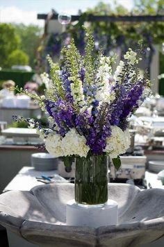 Instead of water, this fountain overflows with purple and white delphiniums with white hydrangeas.