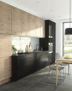 Stunning contrast of raw wood, concrete and smooth black