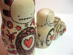 Zombie Russian Dolls - mom, cait, and I each get one a wittle smaller than the other...a family tat! <3