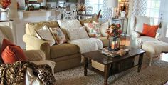 29 Awesome Fall Living Room Décor Ideas With Brown Sofa And White Pillows And Glass Candle Lantern Decor