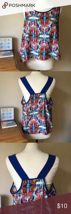 """Xhilaration Colorful Print Crop Top This is such a fun summer top! The style, the colors, the way it shows off your curves effortlessly! Excellent used condition, only worn once. This is a crop top. Lay flat measurements: pit-pit- about 23"""" and top to bottom- about 17"""". Live long and poshper 🖖🏼 Xhilaration Tops Crop Tops"""