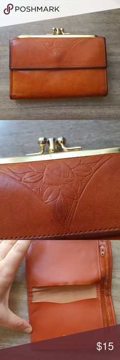 """🌟FINAL DISCOUNT Vintage leather wallet Leather wallet with double kiss snaps and bifold fold out wallet. Im very good condition with small repair on back. Repair does not impede wallet use. Measures 5.25"""" wide by 3.5"""" high with 6.5"""" bifold. Beautiful floral detail at front pocket. Vintage Bags Wallets"""