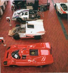 Porsche Raceshop 1972 with the Red Weissach TAXI 917 in the foreground and the 1972 LeMans winner @ the top