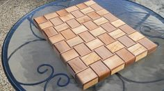 Basket weave design cuttingboard made from hard maple and walnut. This unique design provides not only a durable cutting surface but is also ascetically pleasing as it creates the illusion that the wood is actually woven together. (3/3)