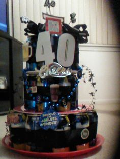 40th bday beer cake I created. Can use fun scrapbooking stickers to decorate, candles on top and draped w/ fun necklace for the garland. I used about 24 cans of beer & wrapped w/ thick ribbon on each layer to hold together on plates.