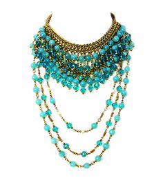 Turkusowa kolia z kamieni naturalnych, kryształów, elementów złoconych oraz długich, efektownych naszyjników.