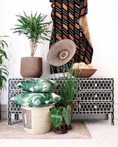 Village - Urban Jungle A distinguished blend of tribe & tropical creates this urban twist that's both bold & lush! ••• Featured: Chainlink Bone Sideboard, Mudcloth, Makenge Basket (on stand) & Banana Leaf Cushions. Explore our products online.