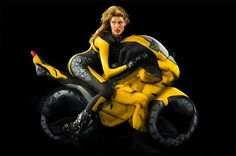 Bodypaint motorcycle with human bodies