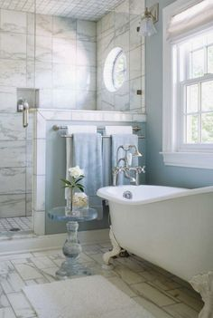 Bathroom with ight blue walls with white/grey marble