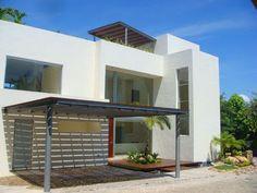 Fachadas Minimalistas: Fachada de casa minimalista con cochera techada ti...