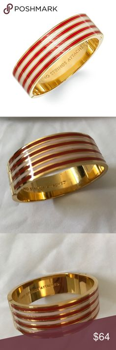 Kate Spade No Strings Attached Bangle Bracelet This is a never worn Kate Spade Bangle Bracelet. Pink,red and gold. inscription reads ''no strings attached'' inside measures: 2.25''h x 2''w weight: 57g imported baby and hot rose pink stripes Product Dimensions	3.9 x 3.1 x 1.3 inches kate spade Jewelry Bracelets