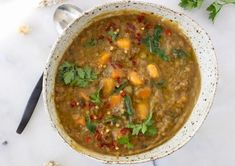 Moroccan Sweet Potato Lentil Stew recipe with cumin, coriander and smoked paprika.