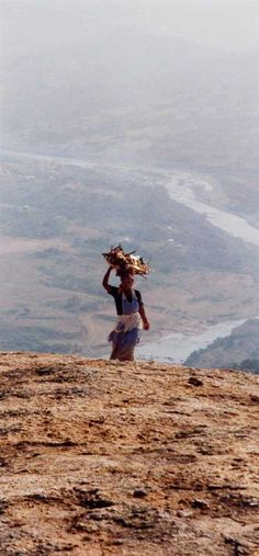 Travelling across miles, she will carry that basket perfectly the entire way - incredible! - Woman returning from work, in the KwaZulu-Natal highlands of South Africa