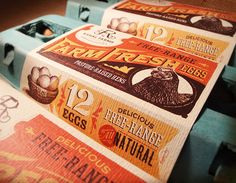A colored carton with a wrap-around label that featured custom typography and illustration in complementary colors