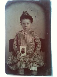 "Love this ""in memorium"" tintype of a girl showing a photo of her father. Love it."