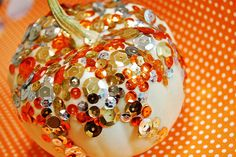 sequins glued on pumpkins - one way to get rid of some of that EXCESS craft supplies we have on hand!!