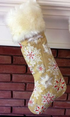 This extra special stocking is made with high quality cotton and a luxuriously soft cream faux fur trim flecked with gold. The body features beautiful cream snowflakes accented with cheerful red and gold shimmer on a golden backdrop  All stockings are fully lined and ready to fill with goodies! Finished product measures approximately 19 long and 6 wide. Custom orders are welcome! View our other listings for coordinating stockings. Canadian orders are guaranteed to arrive by Dec. 25 if…