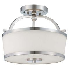 **Showcasing an etched glass shade and a satin nickel finish, this lovely semi-flush mount casts a warm glow in your living room or entryway.