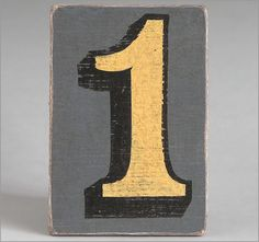 Hand-painted grey wooden number sign: '1'