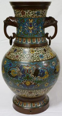 Antique Chinese champleve vase. Has a beautiful design depicting Phoenix, dragons and lotus blossoms