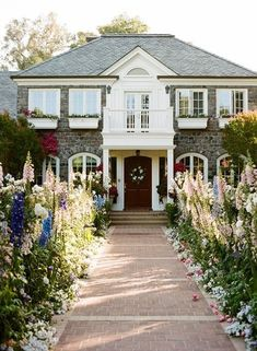 Stone house, white accents, gorgeous gardens